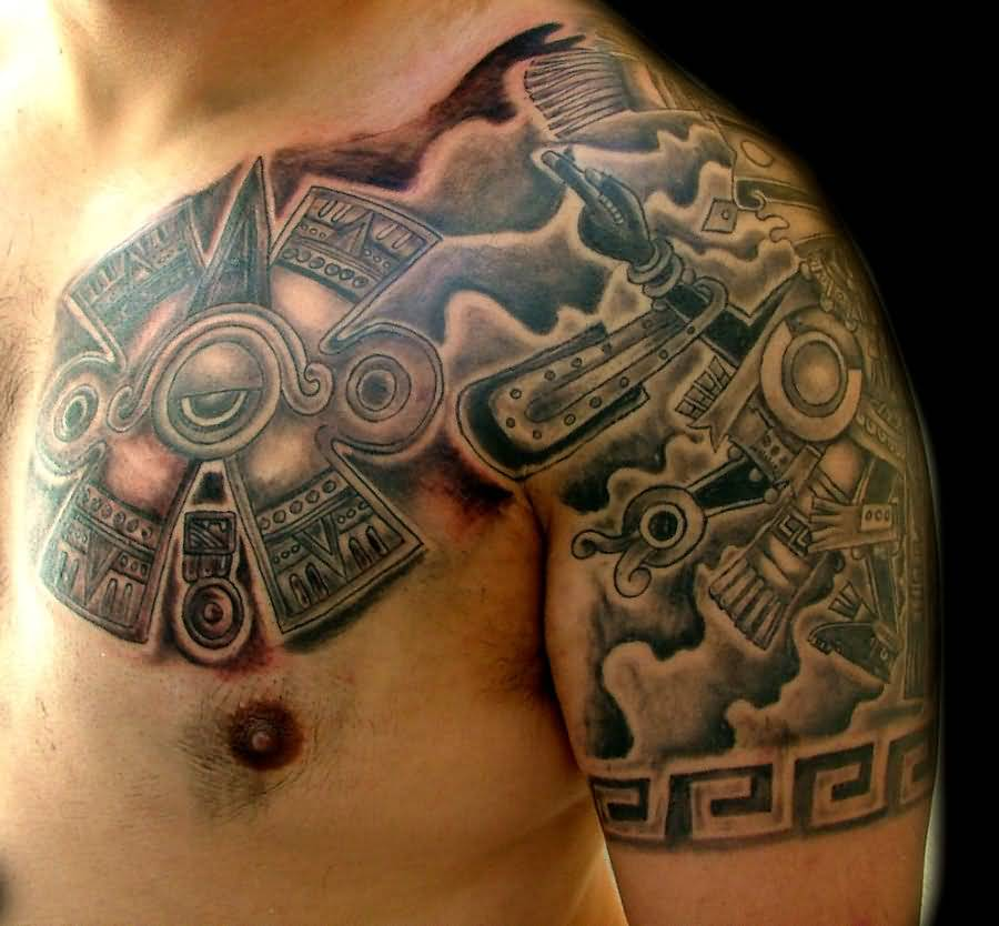 https://www.askideas.com/media/61/Mexican-Mayan-Tattoo-On-Chest-And-Shoulder-by-Piglegion.jpg